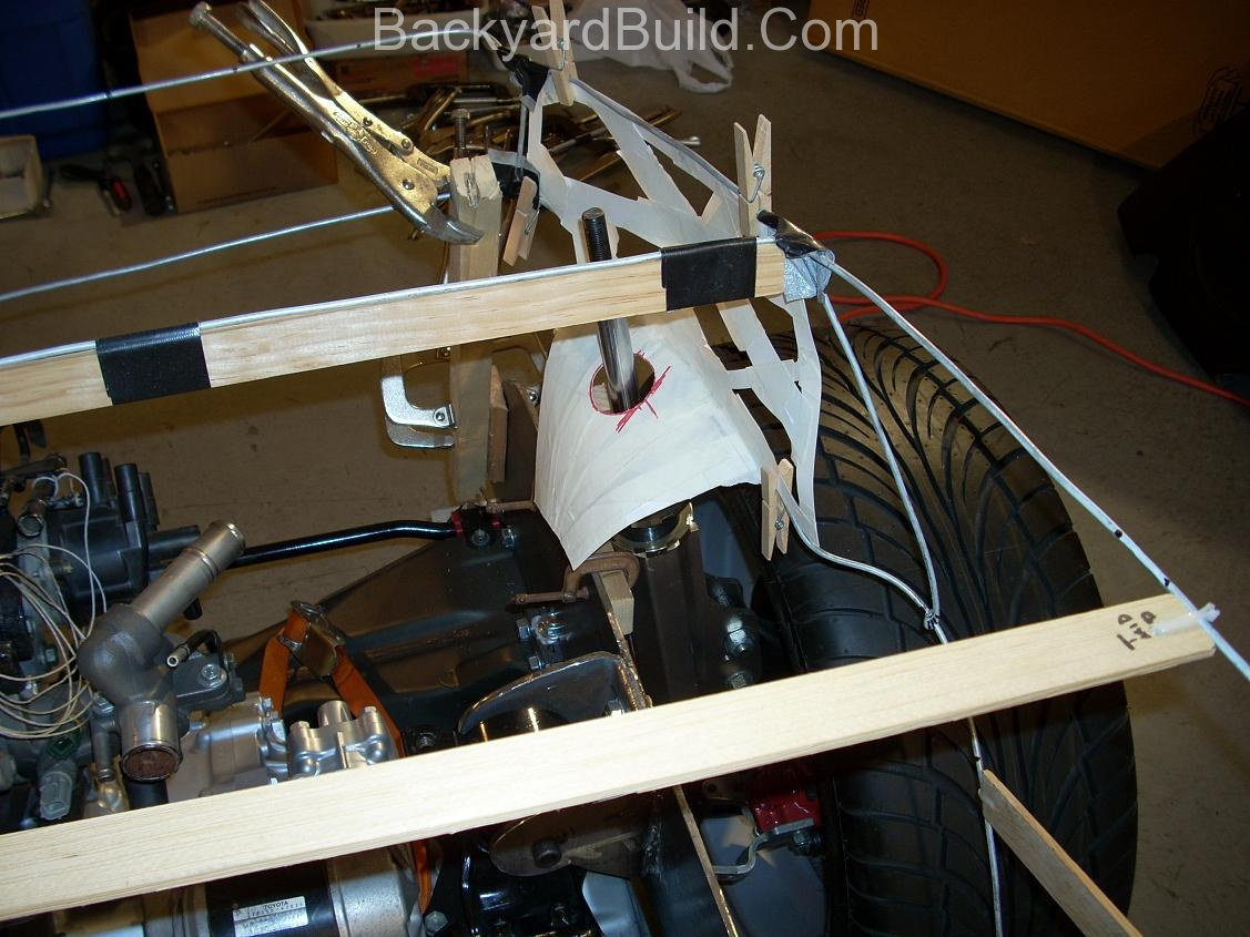 Reinstall rear basket and create strut location panels 15