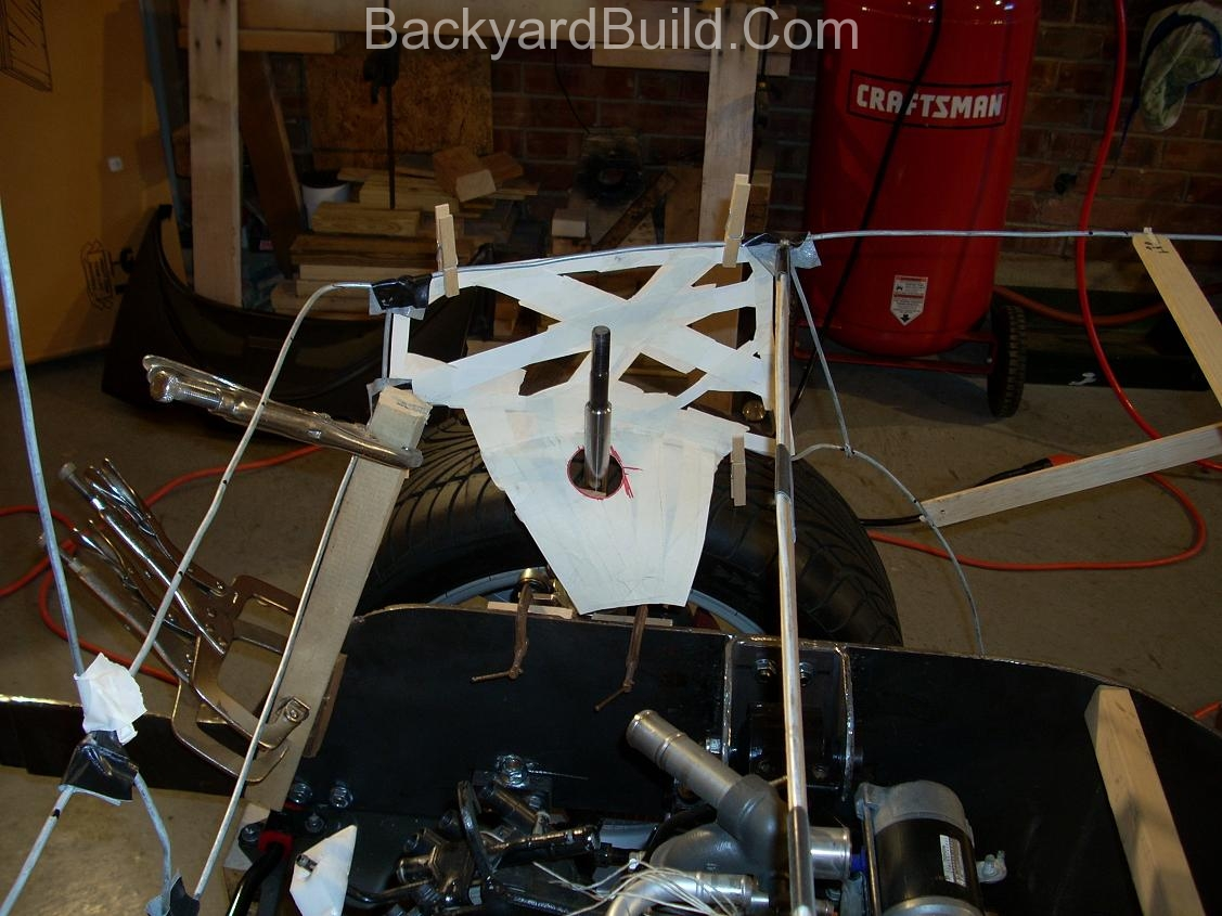 Reinstall rear basket and create strut location panels 13