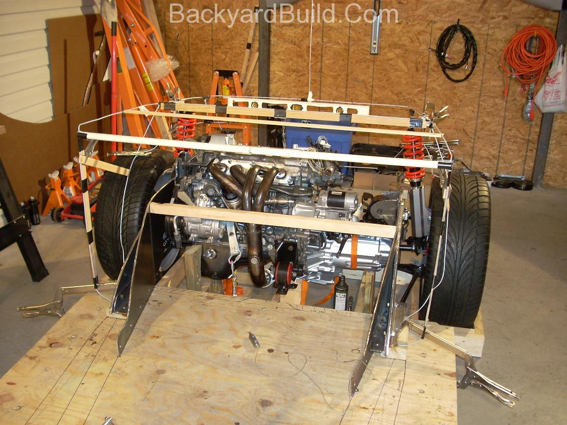 Reinstall rear basket and create strut location panels 1