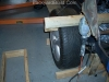 Connect rear strut link to frame 25